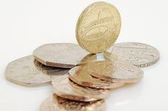 Brittiskt pund och encentmynt Royaltyfria Bilder