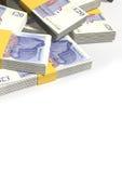Brittiskt pund Sterling Notes Scattered Pile Royaltyfri Bild