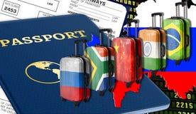 Brix länder: Kina Ryssland som är södra - afrikansk republik, Brasilien, Indien i form av flaggor på resväskor, plan biljett som  royaltyfria foton