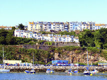 Brixham, Devon, UK. Hillside terraced and tiered houses taken from the ferry at Brixham, Devon, UK Royalty Free Stock Photo