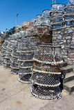 BRIXHAM, DEVON/UK - JULY 28 : Lobster pots stacked against the h Royalty Free Stock Photos
