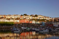 Brixham Harbor Harbour Devon England UK with coloured colored houses in the background and reflections Stock Images