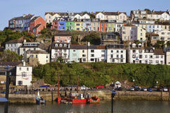 Brixham Harbor Harbour Devon England UK with coloured colored houses and boats Stock Image