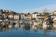 Brixham harbour Devon England during the heatwave of Summer 2013. Brixham marina harbour Devon England with boats on a calm day with blue sky during the heatwave Royalty Free Stock Images