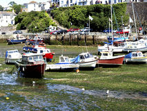 Brixham inner harbour at low tide. Stock Image