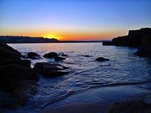 Brixham Sunset across Shoalstone Beach Royalty Free Stock Photo