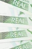 1 BRL valutabakgrund Arkivfoto