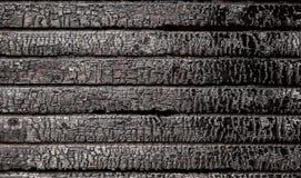 Bränd bruten wood vägg Arkivbilder