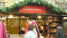 BRNO, CZECH REPUBLIC, DECEMBER 21, 2018: People at the Christmas advent market stall at the square, sale of gifts of. People at the Christmas advent market stall stock video footage