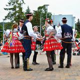 Brno, Czech Republic June 25, 2017. Czech traditional feast. Tradition folk dancing and entertainment. Girls and boys in costumes Royalty Free Stock Image