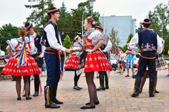 Brno, Czech Republic June 25, 2017. Czech traditional feast. Tradition folk dancing and entertainment. Girls and boys in costumes Stock Photos