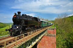Free Brno, Czech Republic, May 19th, 2019. Beautiful Old Steam Train Driving Along A Bridge In The Countryside. Concept For Travel, Stock Photo - 150592870