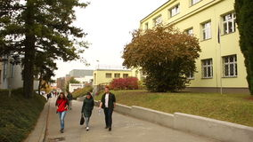 BRNO, CZECH REPUBLIC, OCTOBER 15, 2016: Students Mendel University in Brno go to. Students Mendel University in Brno go to and from school, girls, boys stock footage