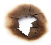 Bränt hål av papper Arkivbild