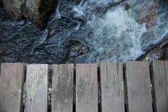Bro nära vattenfallet Royaltyfria Bilder