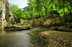 Bro och flod Fotografering för Bildbyråer