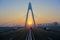 Bro och solnedgång Fotografering för Bildbyråer