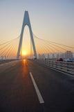 Bro och solnedgång Royaltyfri Foto