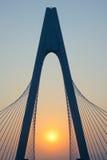 Bro och solnedgång Royaltyfria Bilder