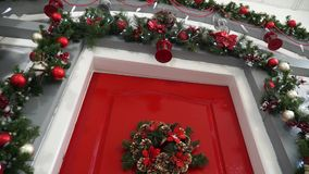 Broaching view of the door decorated for Christmas stock video footage
