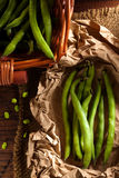 Broad Beans. Raw Broad Beans in a Wicker Basket and Paper Stock Image