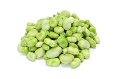 Broad beans. A pile of raw broad beans on a white background Stock Images