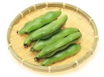 Broad beans in a bamboo colander Stock Image