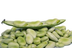Broad beans. Close up view of some broad beans isolated on a white background royalty free stock images