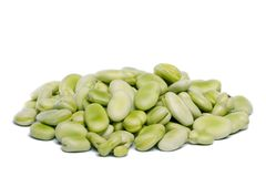 Broad beans. Close up view of some broad beans isolated on a white background royalty free stock photos