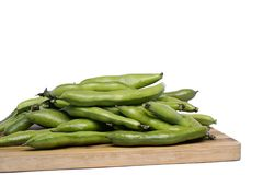 Broad beans. Close up view of some broad beans isolated on a white background stock images