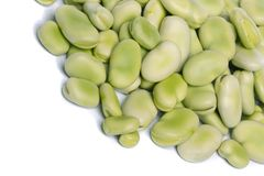 Broad beans. Close up view of some broad beans isolated on a white background stock photo