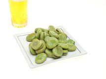 Broad beans and glass beer Royalty Free Stock Images