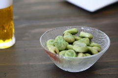 Broad beans and glass beer Stock Photography
