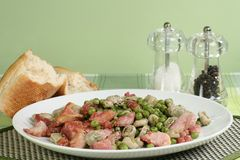 Broad beans peas and bacon Stock Photography