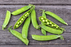Broad beans of peas on old wood Royalty Free Stock Photos