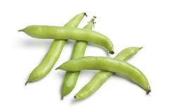 Broad beans in pod. Fresh raw Broad beans in pod on white background Stock Image