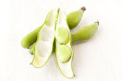 Broad beans in a pod Stock Image
