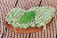 Broad beans puree on toast. Stock Images