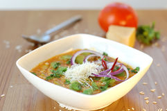 Broad beans soup. With red onion and Italian parmesan cheese, in a white bowl Stock Images