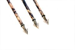 Broad-head arrows. Three broad-head arrows on white Royalty Free Stock Images