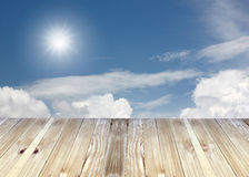 Broad planks and blue sky of blur background. Royalty Free Stock Image