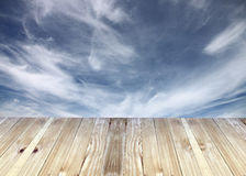 Broad planks and bule sky blurs of background. Stock Image