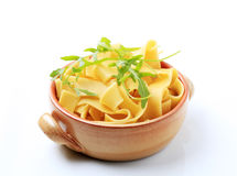 Broad ribbon pasta. In an earthenware pot royalty free stock image