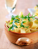 Broad ribbon pasta. In an earthenware dish stock photos