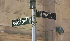 Broad St to the Left and Wall St to the Right Signboard Stock Photo