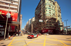 Broad street with skyscrapers and fast cornering taxi cab of Hong Kong Royalty Free Stock Image