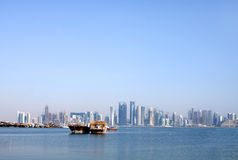 Broad view of Doha skyline & a dhow of Qatar Stock Images
