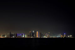 Broad view of Doha skyline at night, Qatar Royalty Free Stock Photography