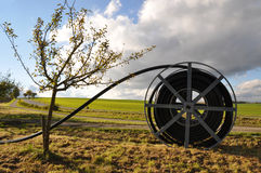 Broadband access for rural areas. Big cable drum with black fiberglass wire for broadband access in rural area in germany royalty free stock image