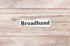 Broadband of the word on paper. concept. Words of Broadband on a wooden background.  stock photos